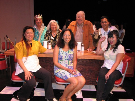 "On the set of ""Stories of the Sun Café"": (seated, from left) cast member and co-writer Gingerlily Lowe-Brisby, co-writer Thelma Virata de Castro, cast member and co-writer Carol Cabrera; (standing, from left) cast member Alan Goya, Joyce Nabeta Teague, project liaison for the Japanese American community, director and co-writer Kent Lowe-Brisby, cast member Jet Antonio."