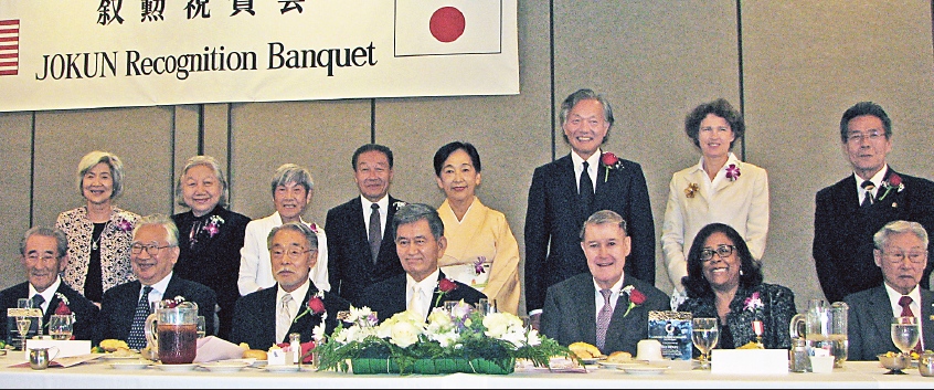 At the head table: (seated, from left) Honorees Shinkichi Koyama, Hiroo Kanamori, Minoru Tonai, Toshio Handa, Peter O'Malley, Jan Perry, Yukio Tatsumi; (standing, from left) Fumiko Koyama, Keiko Kanamori, Mary Tonai, Mel Tatsumi, Toshiko Handa, Consul General Harry Horinouchi, Sabine Horinouchi, JCCF President Yoshio Lee Aoki.