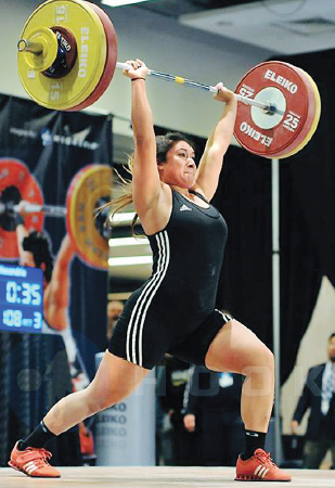 Ali Ludwig lifts 108 kilograms (238 pounds) in the clean and jerk at the American Open, on Dec. 14, 2014 in Washington D.C. She placed fourth in the meet, which was her first national competition. (Photo courtesy Hookgrip)
