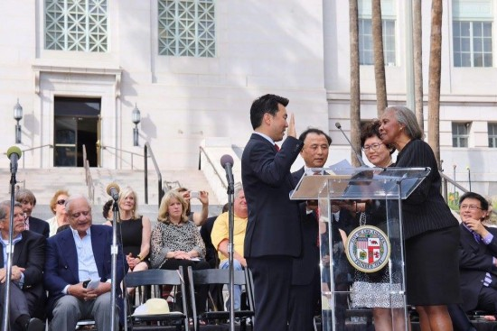 Former Los Angeles County Supervisor Yvonne Burke swears in David Ryu as a City Council member outside City Hall. He is accompanied by his parents, Eul-joon and Michelle. At right is State Treasurer John Chiang.