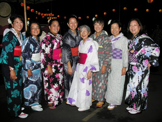 Pictured at last year's Bon Odori last year are dance instructors Ann Ong, Avis Honda, Kimberly Midori Kruse, Jamie Shimizu, Shirley Omori, Susan Moribe, Junko Kajita (leader) and Joanne Hotta. They will teach the dances again this year. (Photo by Tad Muraoka)