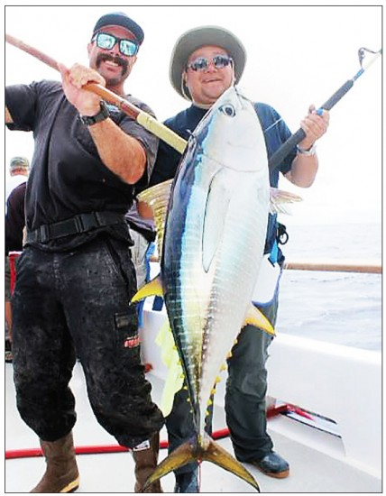 : Eric Hayashi holds up a yellowfin he caught aboard the Excel.