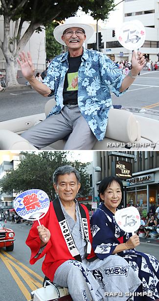 グランドパレードで手を振る【写真上】リチャード・フクハラさん【同下】半田さん(左)と妻の俊子さん