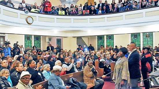 """Voice of Selma"" Bettie Mae Fikes (standing, front) singing freedom songs at Tabernacle Baptist Church in Selma. (Photo by Mike Murase)"