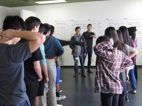 As he leads the cultural values session, Craig Ishii elicits assistance from Brandon Chung.