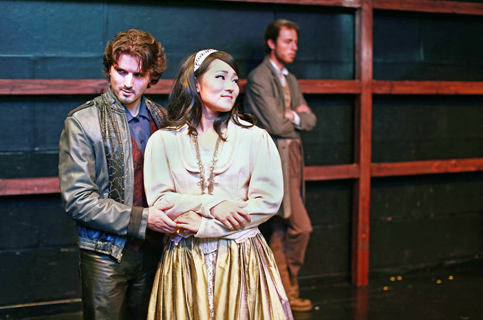 As Horatio (David Flack) broods behind, Hamlet (Josh Bross) confides in Ophelia (Alpha Takahashi), in a new theater project at the OC-centric play festival, running through Sunday at Chapman University. (Photo by Kazuya Kimura)