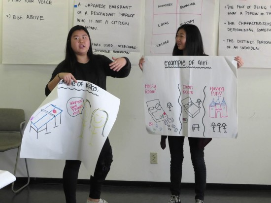 Taryn Manaka and Kaitlyn Chu make a presentation at the cultural values session.