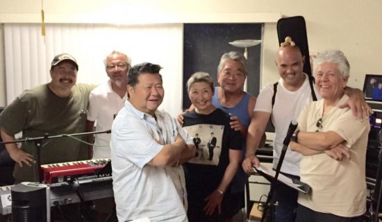 The Atomic Project features (from left) Randy Yoshimoto, Benny Yee, Johnny Mori, Atomic Nancy, Dane Matsumura, Fred Schreuders and Jess Acuna.