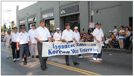 Members of Japanese American Korean War Veterans marching in last year's Nisei Week Parade. (Photo by Bacon Sakatani)
