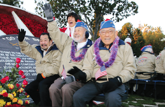 """Masao """"Mas"""" Takahashi (center) waves to onlookers during the Rose Parade on Jan. 1. He passed away on July 25 at his home in Torrance."""