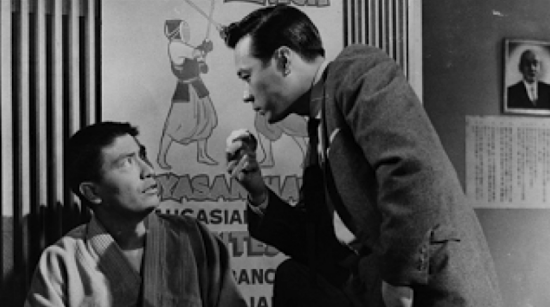 "George Yoshinaga (left) and James Shigeta in a scene from the 1959 film ""The Crimson Kimono."""