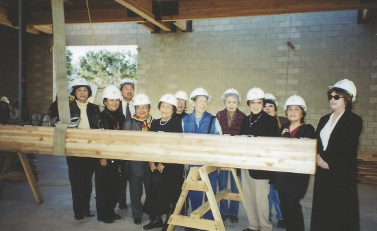 Signing a beam during construction of the library were (from left) Cathy Chang (former senior librarian), Friends board members Janet Minami (first vice president and former president), Larry Kuromiya (president and former treasurer), Geri Witt (vice president of Board of Library Commissioners), Rita Walters (Board of Library Commissioners and former city councilmember), Fontayne Holmes (city librarian), Friends board members Sue Kunitomi Embrey, Michiko McKnight, Tomi Yonemoto (founder and former president), Candy Arai (former treasurer), Irene Murashige (second vice president and former president), and Los Angeles Public Library staff.