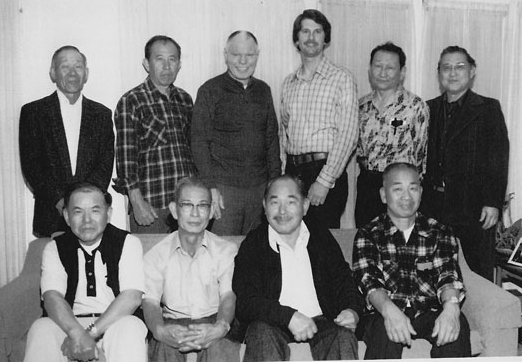 Some of the Discipline Barrack Boys gathered in 1982 with Charles Edmund Zane and Paul Minerich, back row, third and fourth from left. (Photo courtesy of Kenjiro Hayakawa)