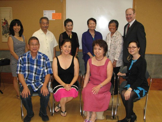 Back row, from left: Friends of Little Tokyo Branch Library board members Alanna Lin Ramage, Ron Hirano (recording secretary), Janet Minami (first vice president and former president), Kiku Matsumura (third vice president), Jean Miyamoto (corresponding secretary); Senior Librarian Jim Sherod. Front row, from left: Pianist Scott Nagatani (who played at the building's opening in 1995) and vocalist Keiko Kawashima of the Grateful Crane Ensemble; library paintings artist Nancy Uyemura; and current Friends president Juliet Wong. (J.K. YAMAMOTO/Rafu Shimpo)