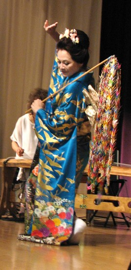 Nancy Teramura Hayata danced in a kimono with a gold crane pattern.