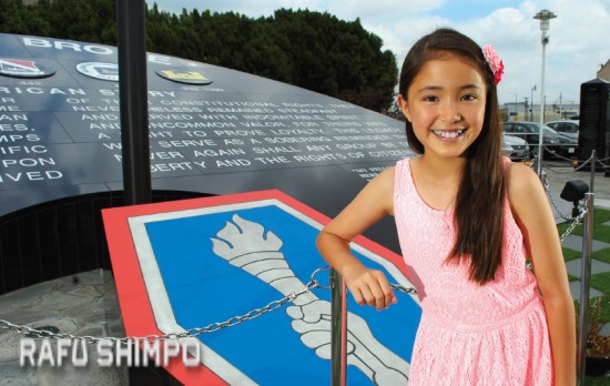 "Jodie Kiyokawa pays a visit to the Go For Broke Monument in Little Tokyo. The 11-year-old from Hawaii will appear in this weekend's ""Peace on Your Wings"" as well as an upcoming film about wartime internment. (MIKEY HIRANO CULROSS/Rafu Shimpo)"