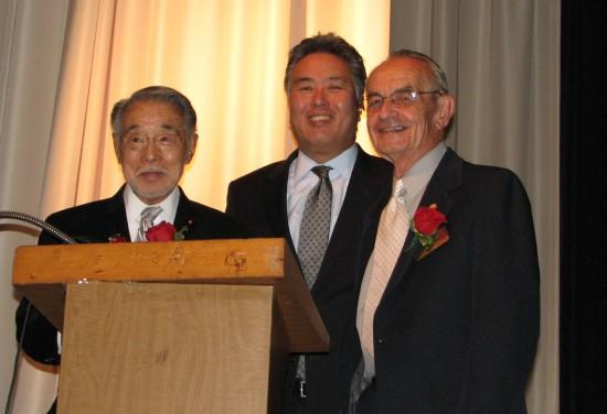 Rep. Mark Takano (center) with honorees Min Tonai and Dr. Lloyd Hitt.