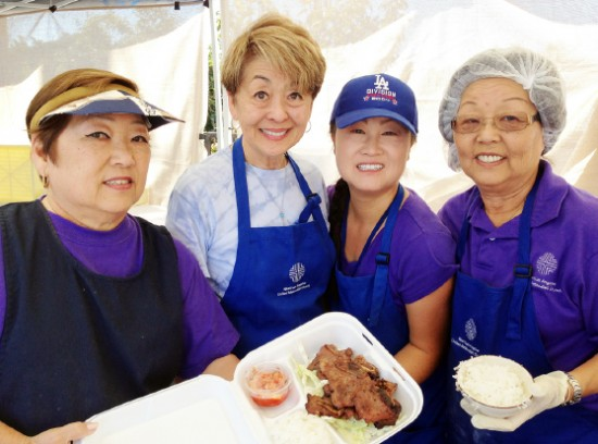 From left: Suzanne Kuwano, Jean Shikata, Lina Yamaguchi and Kazie Kame show off some of the bazaar's delicious Asian cuisine.