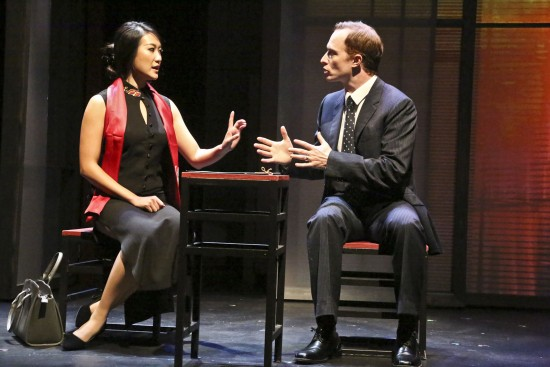 Xi Yan, Vice Minister of Culture, played by Kara Wang, explains a situation to American businessman Daniel Cavanaugh, played by Matthew Jaeger in East West Players production of David Henry Hwang's Chinglish. (Photo by Michael Lamont)