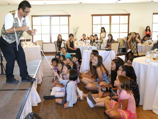 Magician Allen Oshiro entertains the audience and students with his illusions.