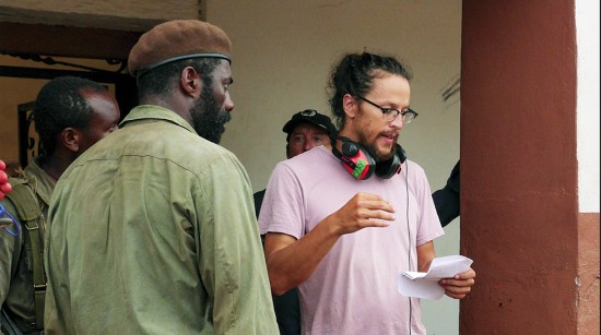"Director Cary Fukunaga on the set of ""Beasts of No Nation."""