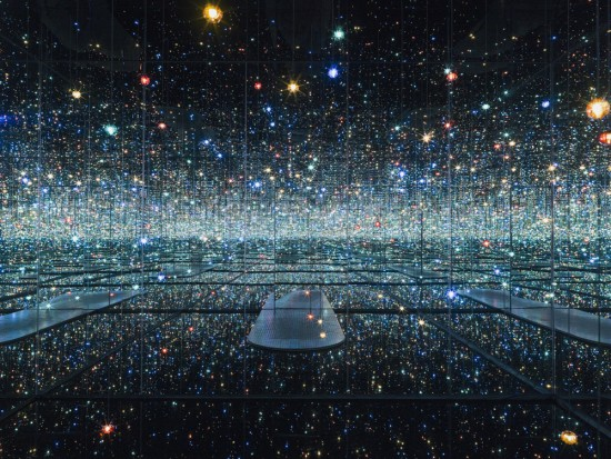 "Yayoi Kusama, ""Infinity Mirrored Room - The Souls of Millions of Light Years Away,"" 2013, wood, metal, glass mirrors, plastic, acrylic panel, rubber, LED lighting system, acrylic balls, and water, 113 1/4 x 163 1/2 x 163 1/2 in., © Yayoi Kusama. Courtesy of David Zwirner, N.Y."