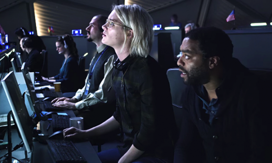 """Mackenzie Davis as Mindy Park and Chiwetel Ejiofor as Venkat Kapoor in a scene from """"The Martian."""""""