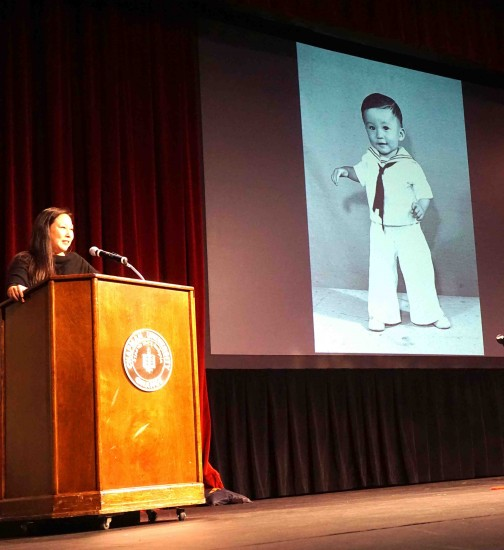 Chapman University Assistant Professor of Sociology Dr. Stephanie Takaragawa discusses her tie to the Heart Mountain story in introducing a photo of her father Ronald Takaragawa at the age of 1, taken by George Hirahara at Heart Mountain in 1945 at the in the Hirahara family's underground darkroom. (Photo by Patti Hirahara)