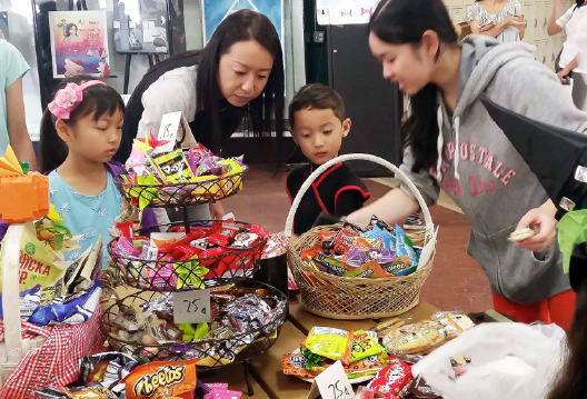 Sellers design their candy shop, determine prices, and compete to attract buyers at Okashiyashiki Candy Sale at Orange Coast Gakeun Japanese Language School on Oct. 31.
