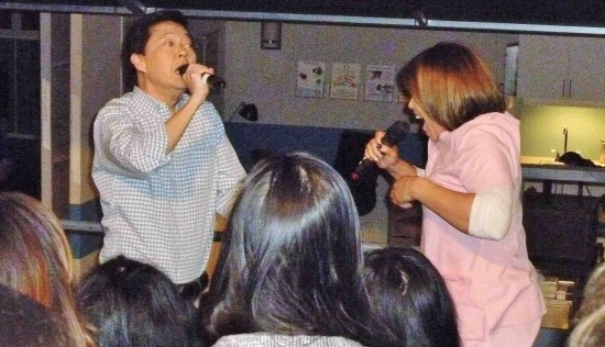 """Ken Jeong and Tisha Campbell Martin sing their own version of """"Always"""" for the studio audience."""