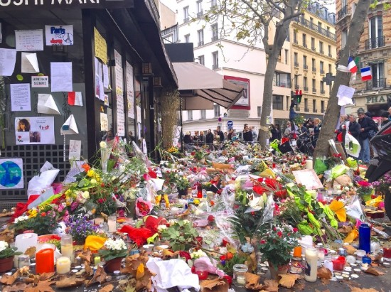 Floral tributes to the victims in front of a café in Paris. This café was one of several sites targeted during the Nov. 13 attacks, and it is located one block away from the author's apartment. (Photo by Kacey Mayeda)