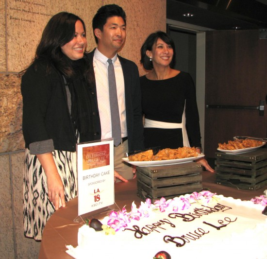 Shannon Lee, Phil Yu and Diana Lee Inosanto pose with cakes celebrating Bruce Lee's 75th birthday.