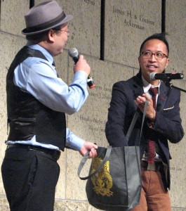 Emcee Aaron Takahashi (left) and Clayton Yeung of Nielsen conduct a drawing for an Apple watch.