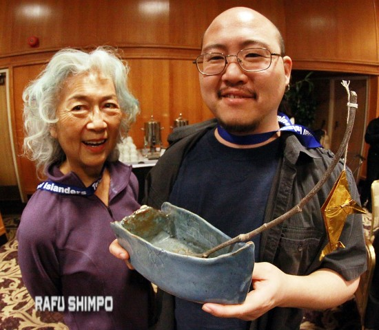 Artist Ernie Jane Nishii and her son Matthew Nishii created centerpieces inspired by Terminal Island fishing boats. (MARIO G. REYES/Rafu Shimpo)