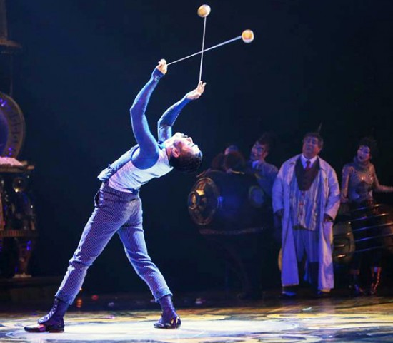 "Twirling two yo-yos simultaneously, Black is the master of time in ""Kurios,"" spinning his pocket watches in all directions. (Martin Girard/shootstudio.ca)"