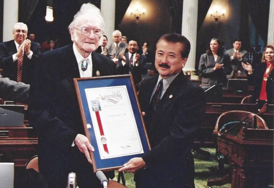 Assemblymember George Nakano presents a commendation to former State Sen. Ralph Dills in 2001.