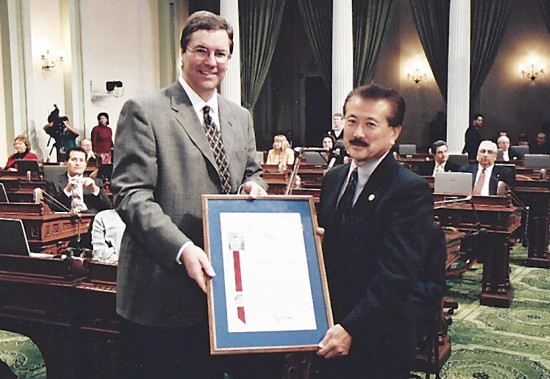 Assemblymember George Nakano presented a commendation to the late State Sen. John Shelley, represented by his son, Assemblymember Kevin Shelley, in 2001.