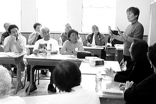 Yasuko Sakamoto conducting a caregiver workshop in 2007.