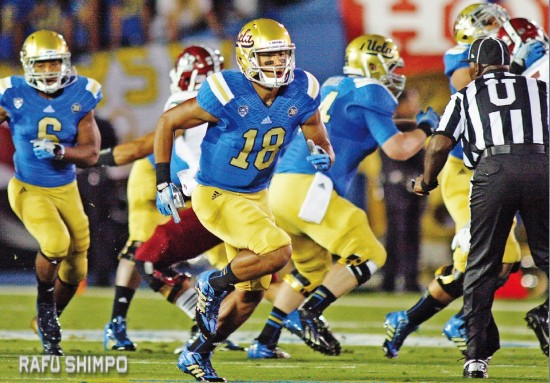 UCLA wide receiver Thomas Duarte (18) runs a play during the Bruins' Sept. 21 game against New Mexico, at the Rose Bowl in Pasadena. Duarte has announced that he will forgo his senior season and make himself available in the upcoming NFL draft. (MARIO G. REYES/Rafu Shimpo)