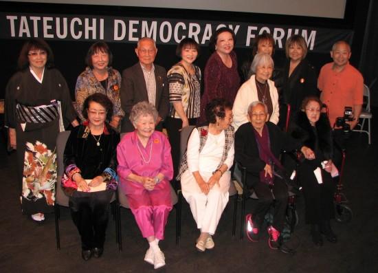 "A screening of ""Hidden Legacy"" at the Japanese American National Museum in 2014 was attended by several interviewees, two of whom have since passed away. Back row, from left: June Aochi Berk, Reiko Iwanaga, Kokko Yutaka Ohigashi, Shirley Muramoto-Wong, Patti Hirahara, Kayoko Wakita, June Kuramoto, Karen Kimura, Alan Miyatake. Front row, from left: Yuki Sato Lee, Miyeko Azeka Kubota, Yukino Okubo Harada, Tokie Kakudo Robinson (deceased), Bando Mitsusa (deceased). (J.K. YAMAMOTO/Rafu Shimpo)"