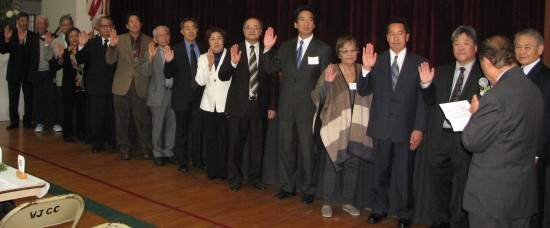 Former Assemblymember George Nakano (right) installs the 2016 officers and board members.