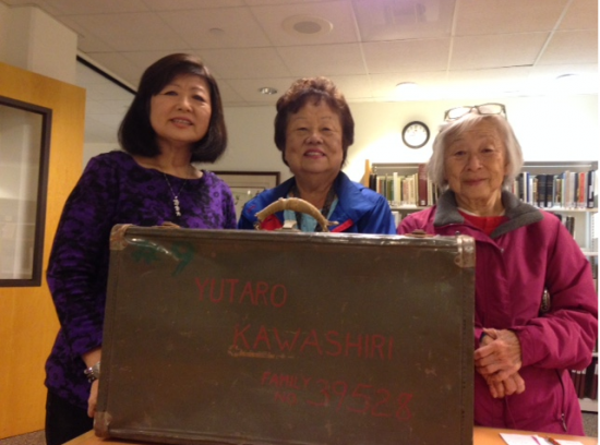 Pictured with Yutaro Kawashiri's suitcase are his granddaughters Hideko Shono (right) and Kathy Kubota (center) with Pauline Hayashibara.