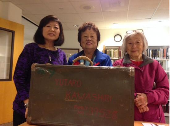 Pictured with Yutaro Kawashiri's suitcase are his granddaughters Hideko Shono (right) and Kathy Kubota (center) with Pauline Hayashibara.
