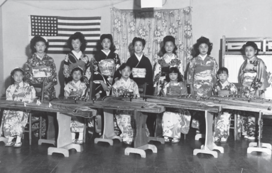 Nobue Wakita, daughter Kayoko Wakita, and koto students at Manzanar. (Courtesy Toyo Miyatake Studios)