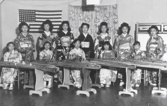 Nobue Wakita, daughter Kayoko Wakita, and koto students at Manzanar. (Courtesy Toyo Miyatake Studios)