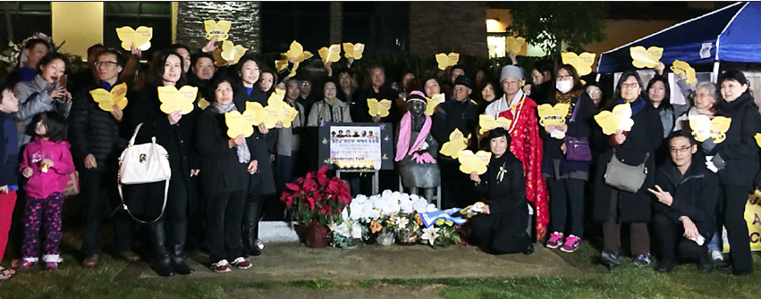 "NCRR (photo right: Janice Yen, Patty Nagano, Haru Kuromiya, David Monkawa, Kathy Masaoka) sent a delegation on Jan. 5 to a candlelight vigil at the Glendale statue of a ""comfort woman"" sponsored by the Korean American Forum of California (KAFC) and the NabiFund to remember those who have passed away and to express support for their continued campaign for a direct apology and redress from the Japanese government for all ""comfort women."""