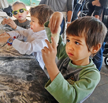 Trying their hand at art of mochi-rolling are Oliver Zaky (front), Sabastian Zaky, and Hunter Shimoda.