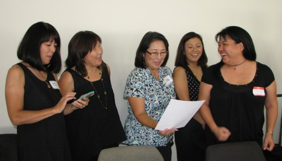 From left: Kathy Tanaka (1976-77), Diana Ono (1976-77), Susan Oiwake (1978-79), Frances Matsumoto (1979-80) and Mika Matsui (1994-95) sing the Waseda fight song.