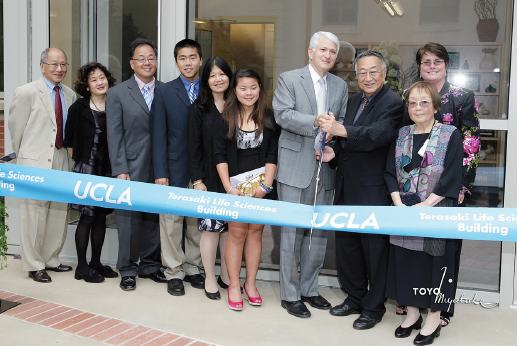 Paul Terasaki and UCLA Chancellor Gene Block cut the ribbon on the new Terasaki Life Sciences Building on Sunday. They are joined by, from right, Victoria Sork, dean of Life Sciences, and members of Terasaki's family, including his wife, Hisako; granddaughter, Susie; daughter-in-law, Cecilia; grandson, Paul; son, Keith; daughter, Emiko; and brother, Richard Terasaki.