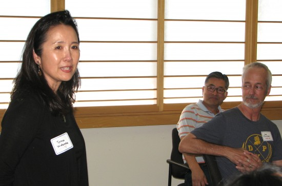 Teresa Watanabe (1977-78) introduces herself as Jon Kaji (1974-75) and Joe Parker (1975-76) listen.